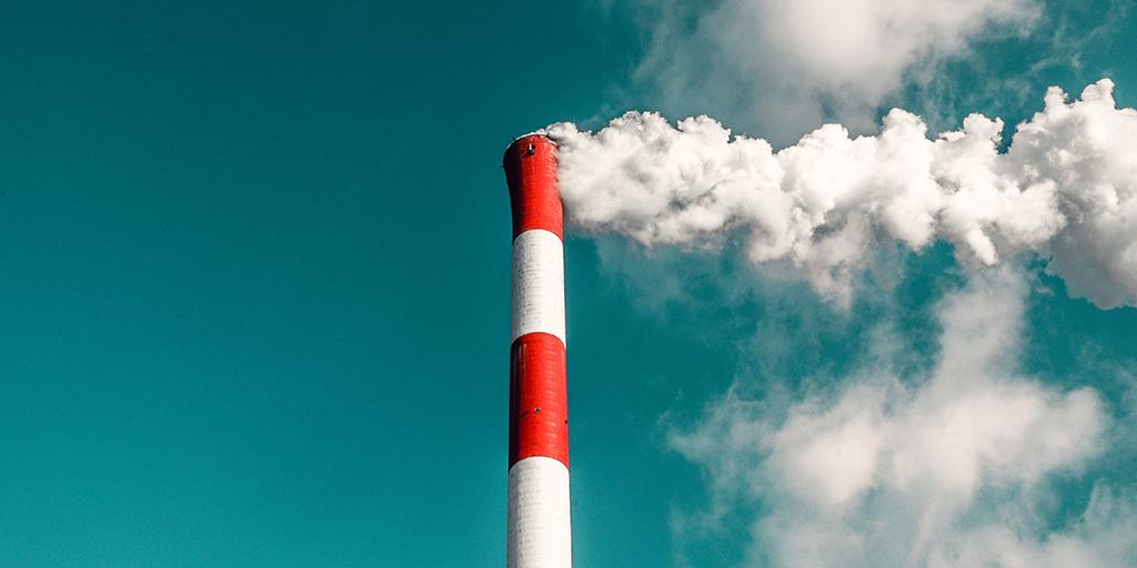 Picture of factory chimney. Published under CC0 Public Domain. Credit: Veeterzy, https://unsplash.com/photos/UwBrS-qRMHo/